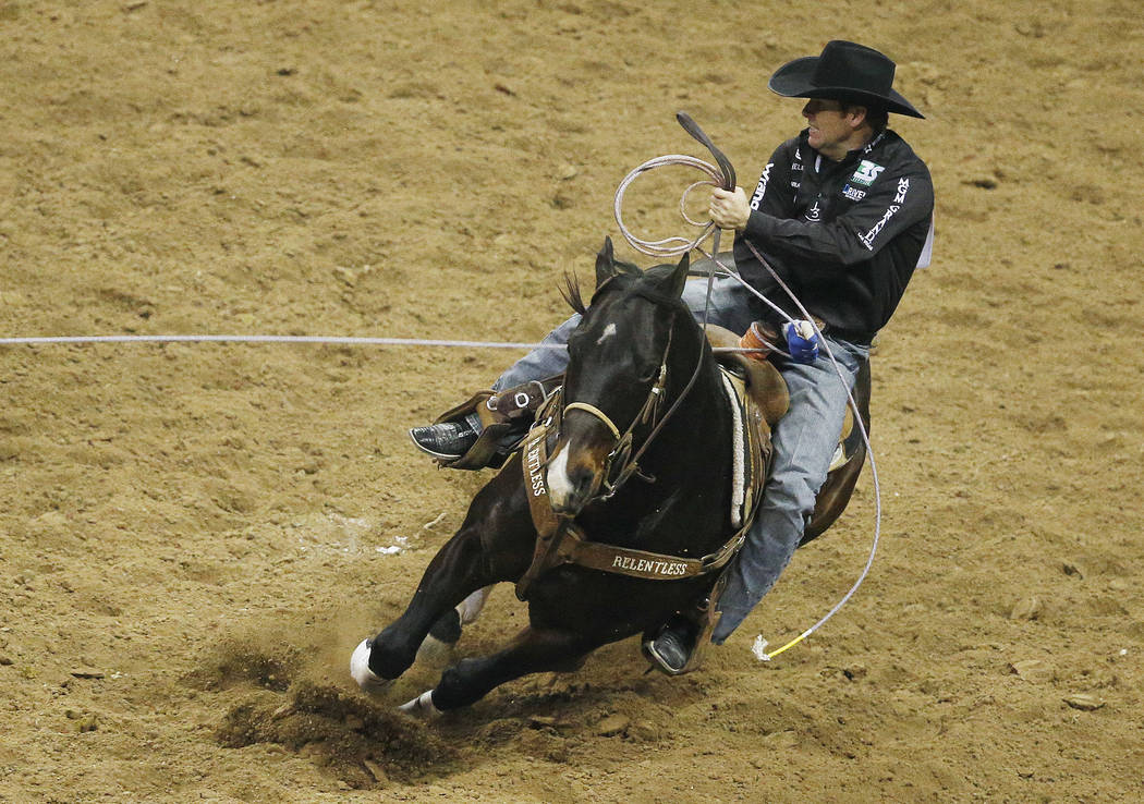 Trevor Brazile competes in the team roping event during the sixth go-round of the National Finals Rodeo, Tuesday, Dec. 8, 2015, in Las Vegas. (AP Photo/John Locher)