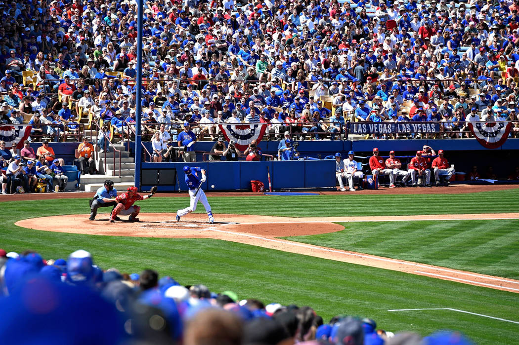 Chicago Cubs third baseman Kris Bryant (17) hits against the Cincinnati Reds during an exhibition baseball game at Cashman Field on Sunday, March 26, 2017, in Las Vegas. CREDIT: David Becker/Las V ...