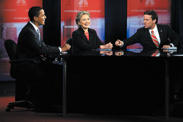 Democratic presidential candidates, Sen. Barack Obama, left, Sen. Hillary Clinton and former Sen. John Edwards share a laugh during the Democratic presidential candidates debate at Cashman Center  ...