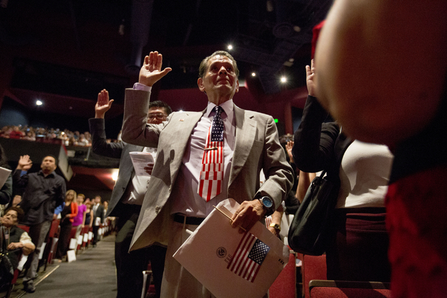 New United States citizens recite the Oath of Allegiance while participating in a naturalization ceremony at Cashman Field Thursday, Sept. 22, 2016, in Las Vegas. (Elizabeth Page Brumley/Las Vegas ...