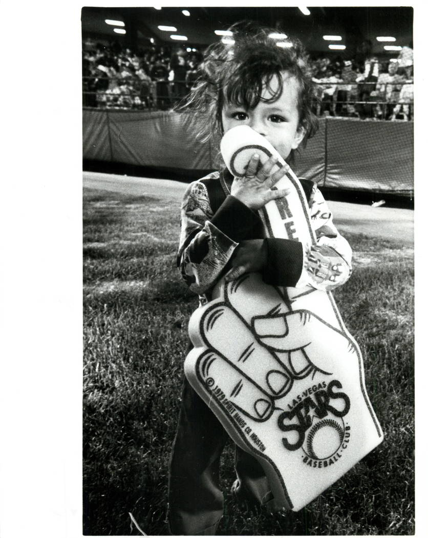 Las Vegas Review-Journal  -   MARCH 31, 1983  LAS VEGAS STARS - BASEBALL - 2 year old Jessica Baugh with Big Hand she won during Easter Egg Hunt at opening of Cashman Field.  (SCOTT HENRY/Las Vega ...