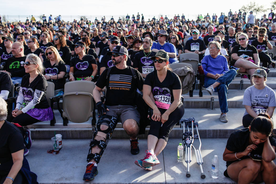 Bob Bradshaw, 46, left, and Cindy Bradshaw, 50, right, both of Simi Valley, Calif., gather with other participants before the start of the Vegas Strong 5K/1M at Craig Ranch Regional Park in North  ...