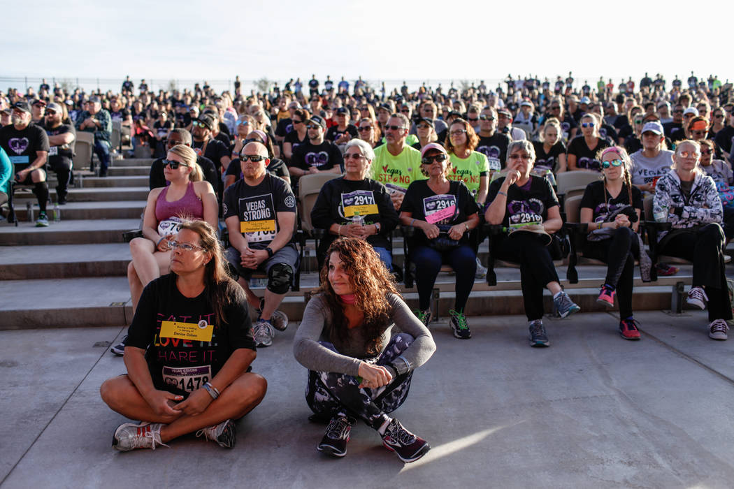 Liza Gripentrog, 52, left, and JoJo Bennington, 51, right, both of Las Vegas, gather with other participants before the start of the Vegas Strong 5K/1M at Craig Ranch Regional Park in North Las Ve ...