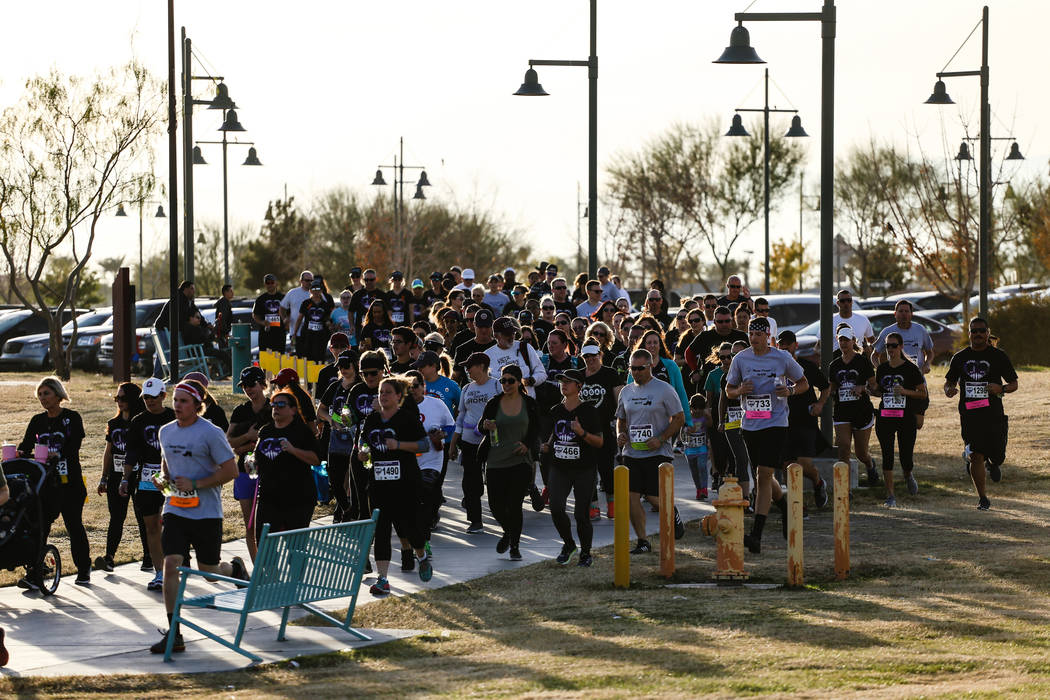 People follow the course during the Vegas Strong 5K/1Mat Craig Ranch Regional Park in North Las Vegas, Saturday, Dec. 2, 2017. Joel Angel Juarez Las Vegas Review-Journal @jajuarezphoto