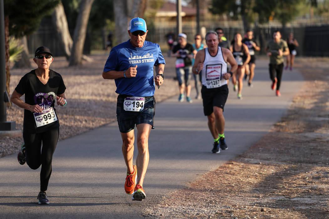 People run along a path during the Vegas Strong 5K/1Mat Craig Ranch Regional Park in North Las Vegas, Saturday, Dec. 2, 2017. Joel Angel Juarez Las Vegas Review-Journal @jajuarezphoto