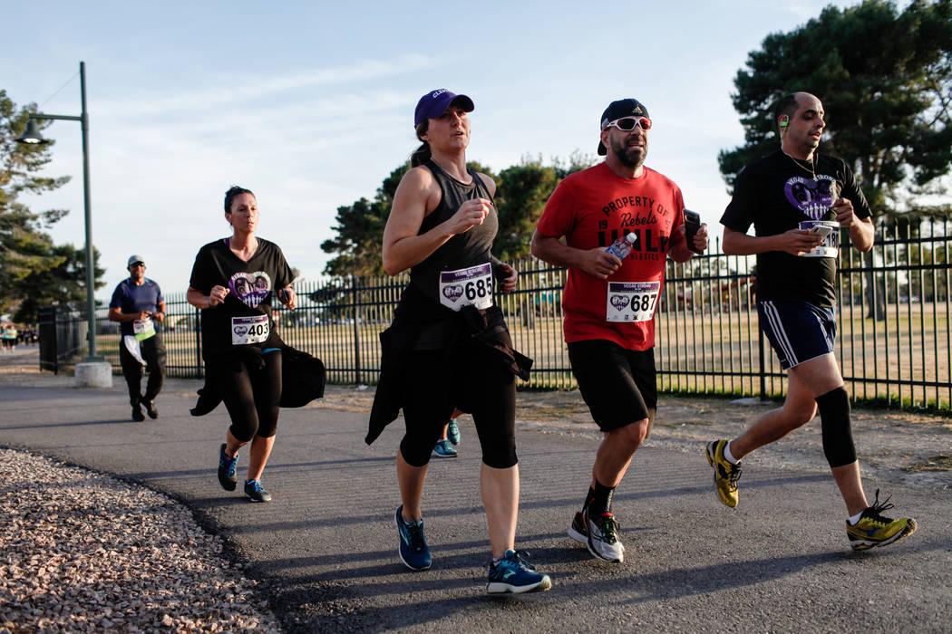 People run along a path during the Vegas Strong 5K/1M at Craig Ranch Regional Park in North Las Vegas, Saturday, Dec. 2, 2017. Joel Angel Juarez Las Vegas Review-Journal @jajuarezphoto