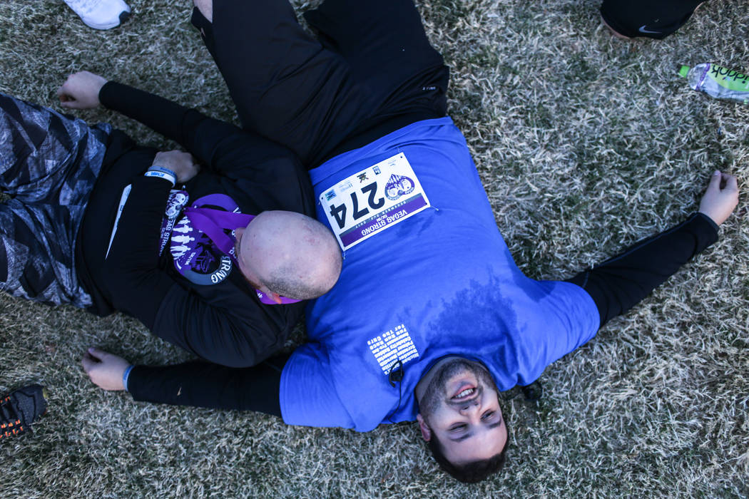Brad Solomon, 22, left, and Adam Almosawg, 22, right, both of Las Vegas, rest after completing the Vegas Strong 5K and 1M run at Craig Ranch Regional Park in North Las Vegas, Saturday, Dec. 2, 201 ...