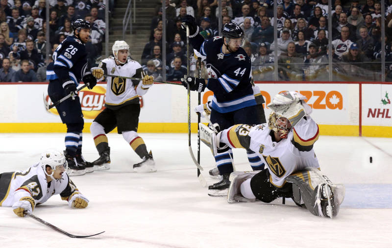 Dec 1, 2017; Winnipeg, Manitoba, CAN;  Vegas Golden Knights goalie Maxime Lagace (33) watches as a puck flys pass Winnipeg Jets defenseman Josh Morrissey (44) in second period action at Bell MTS P ...