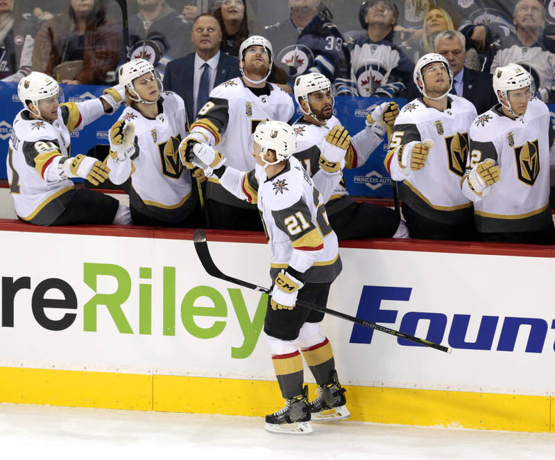 Dec 1, 2017; Winnipeg, Manitoba, CAN;  Vegas Golden Knights center Cody Eakin (21) celebrates his goal n the first period with Vegas Golden Knights players on the bench at Bell MTS Place. Mandator ...