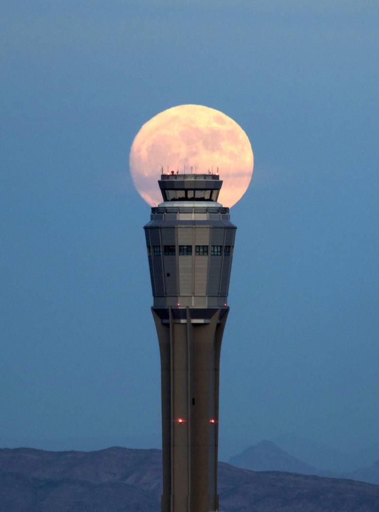 December's nearly full moon rises over an air traffic control tower at McCarran International Airport in Las Vegas Saturday, Dec. 2, 2017. Richard Brian Las Vegas Review-Journal @vegasphotograph