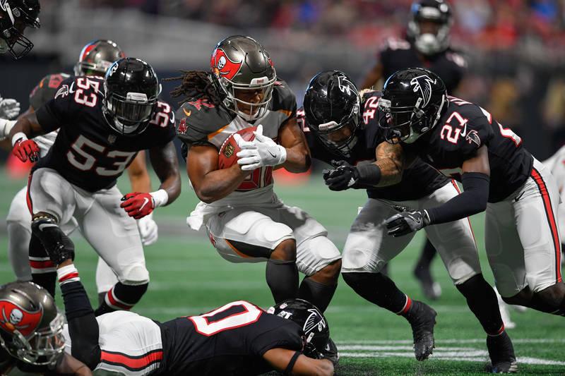 Nov 26, 2017; Atlanta, GA, USA; Tampa Bay Buccaneers running back Jacquizz Rodgers (32) is tackled by Atlanta Falcons linebacker Duke Riley (42) during the first half at Mercedes-Benz Stadium. Man ...