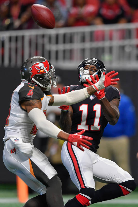 Nov 26, 2017; Atlanta, GA, USA; Atlanta Falcons wide receiver Julio Jones (11) catches a touchdown pass behind Tampa Bay Buccaneers safety Justin Evans (21) during the first half at Mercedes-Benz  ...