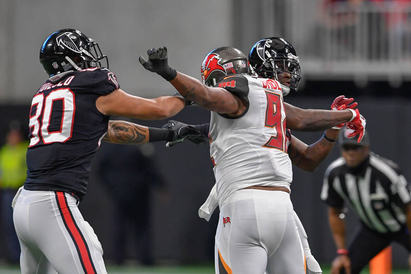 Nov 26, 2017; Atlanta, GA, USA; Atlanta Falcons wide receiver Mohamed Sanu (12) (right) throws a 51 yard touchdown pass to wide receiver Julio Jones (11) (not shown) against the Tampa Bay Buccanee ...