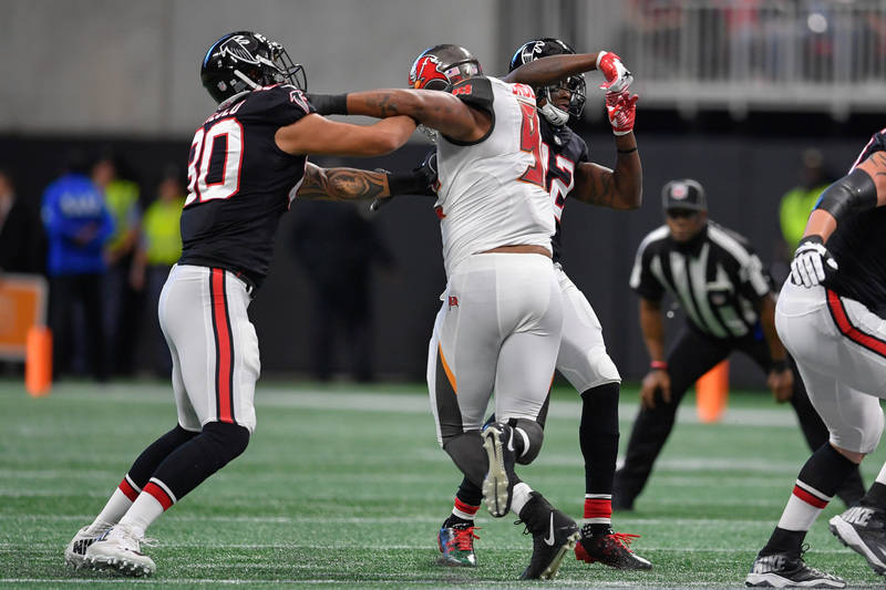 Nov 26, 2017; Atlanta, GA, USA; Atlanta Falcons wide receiver Mohamed Sanu (12) throws a 51 yard touchdown pass to wide receiver Julio Jones (11) (not shown) against the Tampa Bay Buccaneers durin ...