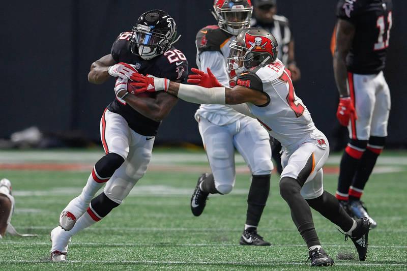 Nov 26, 2017; Atlanta, GA, USA; Atlanta Falcons running back Tevin Coleman (26) runs against Tampa Bay Buccaneers safety Justin Evans (21) during the first half at Mercedes-Benz Stadium. Mandatory ...