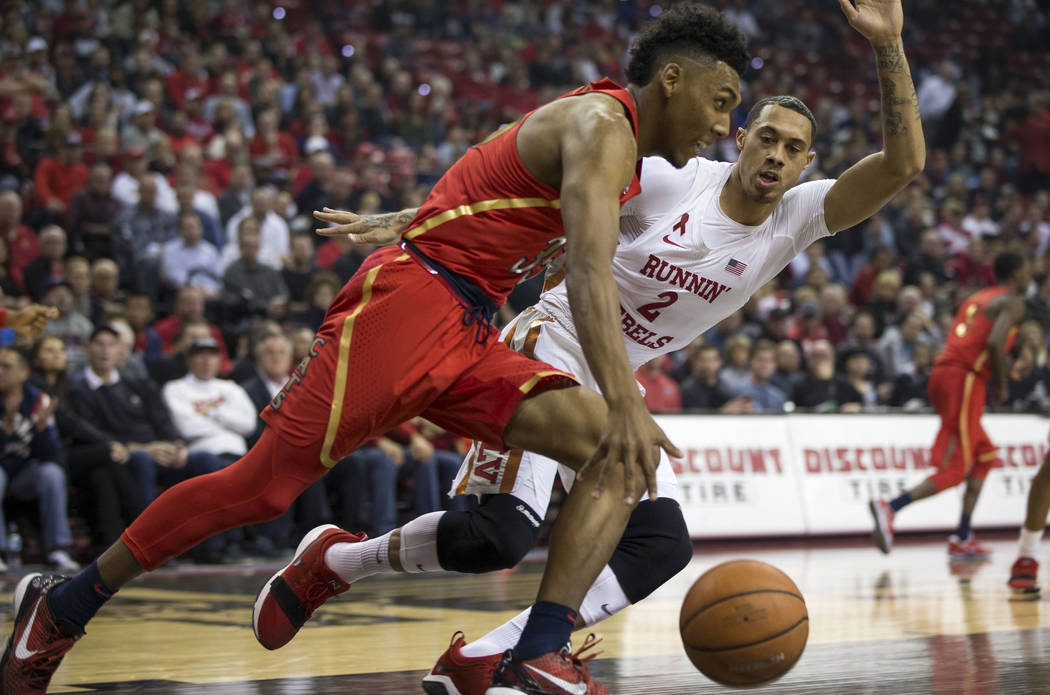UNLV Rebels forward Anthony Smith (2) puts pressure on Arizona Wildcats guard Allonzo Trier (35) during the first half of an NCAA college basketball game at Thomas & Mack Center in Las Vegas o ...