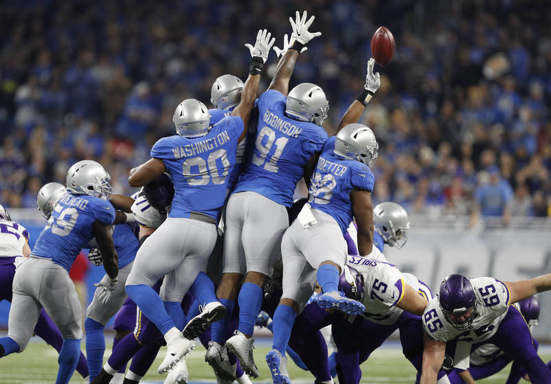Nov 23, 2017; Detroit, MI, USA; Detroit Lions defensive end Jeremiah Ledbetter (98) blocks a field goal attempt during the second quarter against the Minnesota Vikings at Ford Field. Mandatory Cre ...