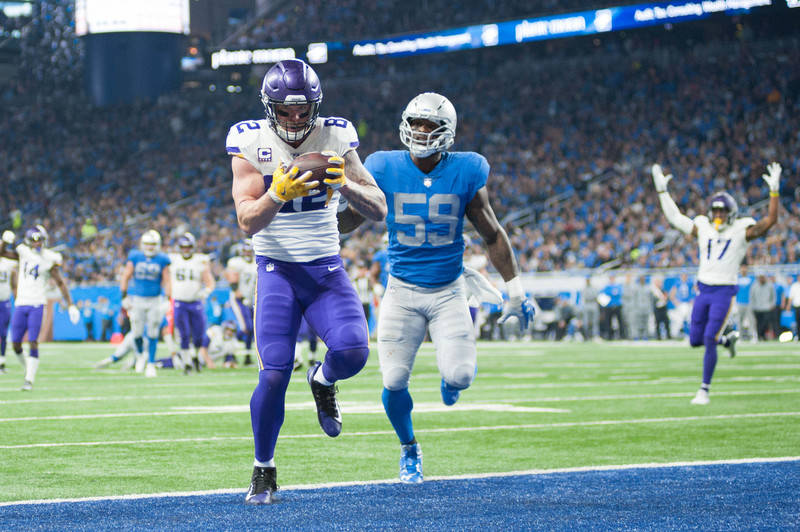 Nov 23, 2017; Detroit, MI, USA; Minnesota Vikings tight end Kyle Rudolph (82) scores a touchdown during the second quarter against the Detroit Lions at Ford Field. Mandatory Credit: Tim Fuller-USA ...