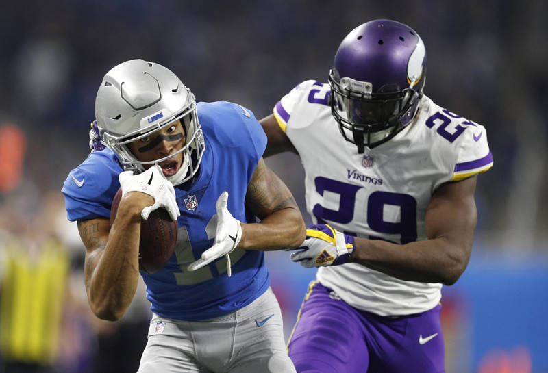 Nov 23, 2017; Detroit, MI, USA; Detroit Lions wide receiver Marvin Jones (11) makes a touchdown catch against Minnesota Vikings cornerback Xavier Rhodes (29) during the fourth quarter at Ford Fiel ...