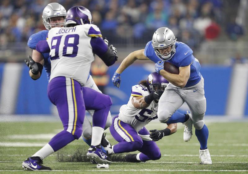 Nov 23, 2017; Detroit, MI, USA; Detroit Lions running back Zach Zenner (34) runs the ball against Minnesota Vikings middle linebacker Eric Kendricks (54) and defensive tackle Linval Joseph (98) du ...