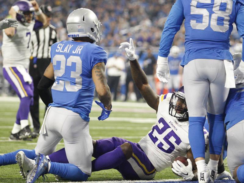 Nov 23, 2017; Detroit, MI, USA; Minnesota Vikings running back Latavius Murray (25) celebrates after scoring a touchdown during the third quarter against Detroit Lions cornerback Darius Slay (23)  ...