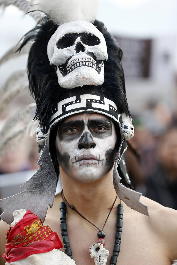 A supporter of the Bears Ears and Grand Staircase-Escalante National Monuments watches during a rally Saturday, Dec. 2, 2017, in Salt Lake City. (AP Photo/Rick Bowmer)