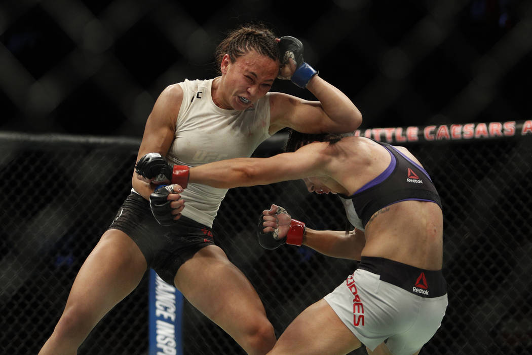 Dec 2, 2017; Detroit, MI, USA; UFC Tecia Torres (red gloves) fights Michelle Waterson (blue gloves) during UFC 218 at Little Caesars Arena. Mandatory Credit: Raj Mehta-USA TODAY Sports