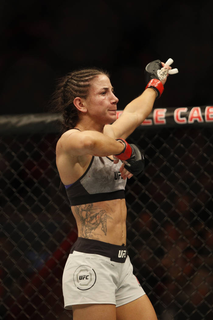 Dec 2, 2017; Detroit, MI, USA; UFC Tecia Torres (red gloves) reacts after fight against Michelle Waterson (blue gloves) during UFC 218 at Little Caesars Arena. Mandatory Credit: Raj Mehta-USA TODA ...