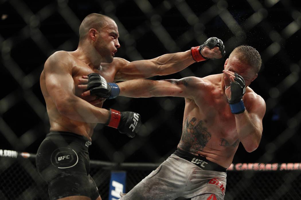 Dec 2, 2017; Detroit, MI, USA; Eddie Alvarez (red gloves) fights Justin Gaethje (blue gloves) during UFC 218 at Little Caesars Arena. Mandatory Credit: Raj Mehta-USA TODAY Sports