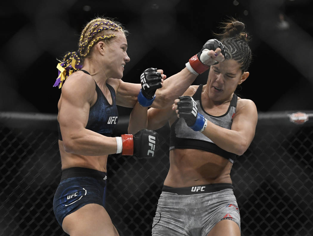 Felice Herrig, left, punches Cortney Casey in the first round during a UFC 218 strawweight match mixed martial arts bout, Saturday, Dec. 2, 2017 in Detroit. Herrig defeated Casey by split decision ...
