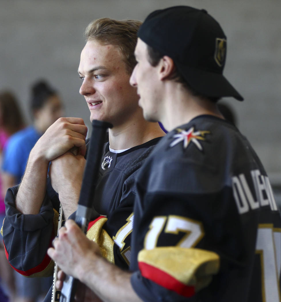 Vegas Golden Knights' Reid Duke, left, and Marc-Andre Fleury during a street hockey clinic for local Las Vegas youth at Paradise Recreation Center, 4775 S. McLeod Drive, on Thursday, June 22, 2017 ...