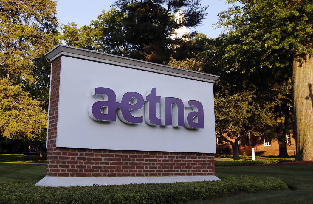 A sign stands on the campus of the Aetna headquarters, in Hartford, Conn., June 1, 2017. CVS will buy insurance giant Aetna in a roughly $69 billion deal that will help the drugstore chain provide ...