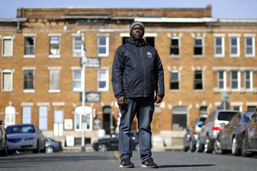 Community outreach worker Kelvin Parker poses for a portrait while walking in the Sandtown-Winchester neighborhood of Baltimore, March 3, 2017. Parker is one of three outreach workers at U-TURNS,  ...