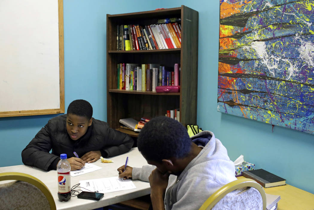 Boys participate in a group therapy session led by community outreach workers at U-TURNS in the Sandtown-Winchester neighborhood of Baltimore, March 2, 2017. U-TURNS offers teens and young adults  ...