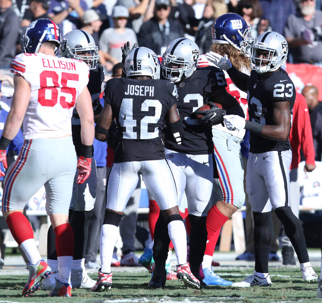 Oakland Raiders middle linebacker NaVorro Bowman (53) celebrates with strong safety Karl Joseph (42) and cornerback Dexter McDonald (23) after recovering a New York Giants fumble during the first  ...