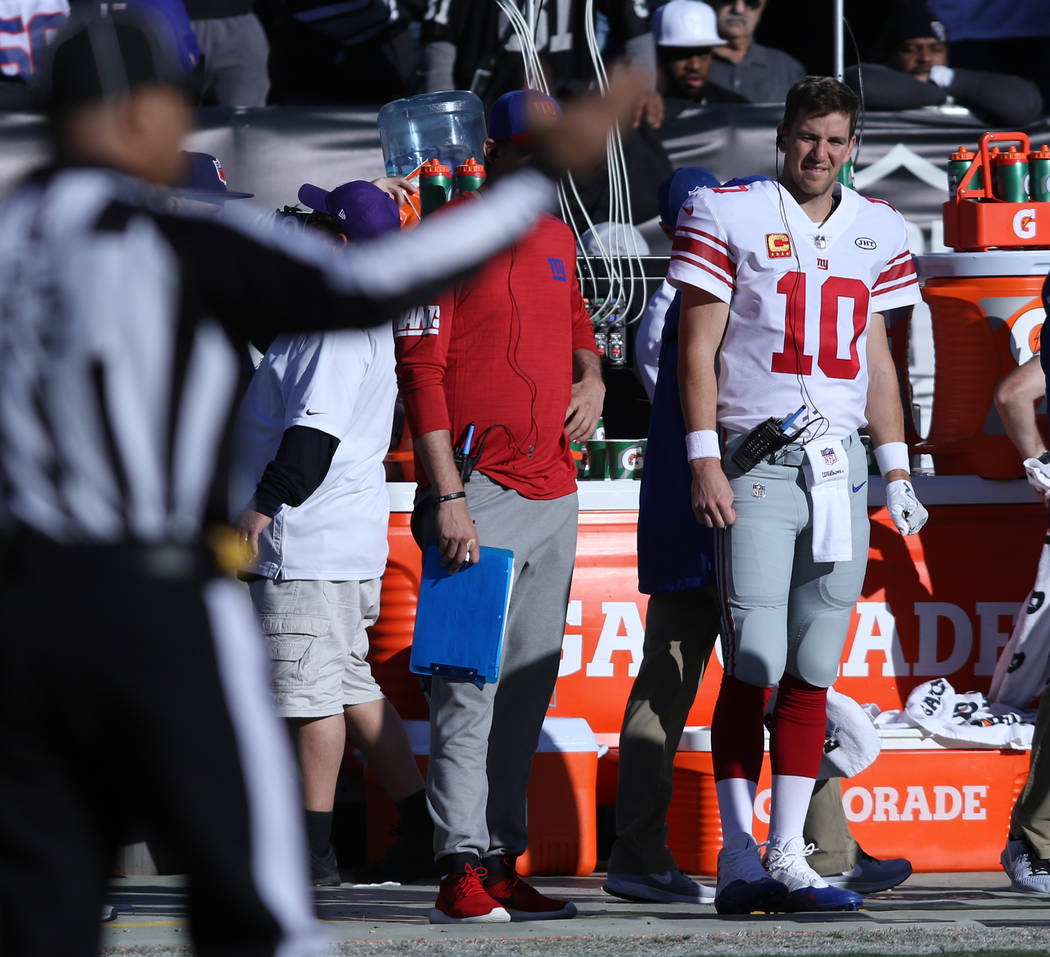 New York Giants quarterback Eli Manning (10) watches his team play the Oakland Raiders from the sideline during the first half of a NFL game in Oakland, Calif., Sunday, Dec. 3, 2017. Heidi Fang La ...