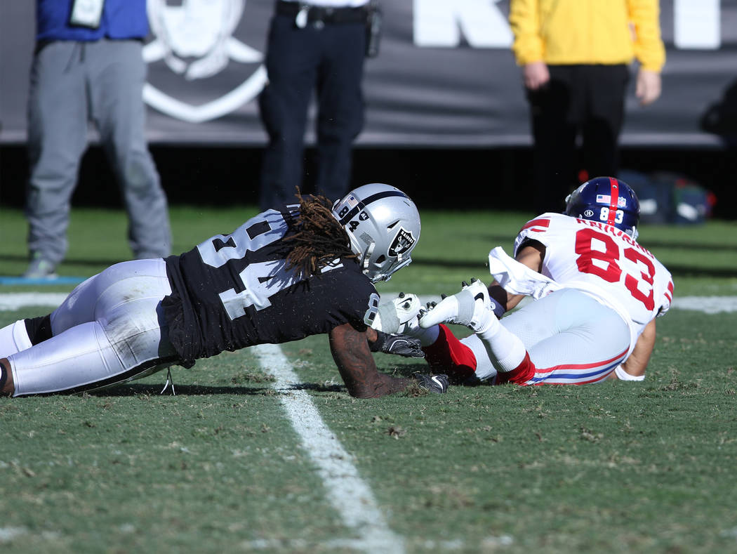 Oakland Raiders wide receiver Cordarrelle Patterson (84) tackles New York Giants wide receiver Kalif Raymond (83) on a punt return during the first half of a NFL game in Oakland, Calif., Sunday, D ...