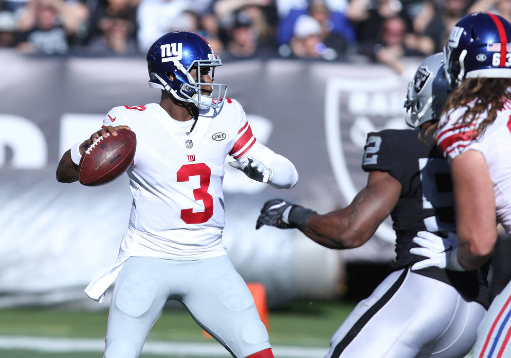 New York Giants quarterback Geno Smith (3) prepares to throw the football during the first half of a NFL game against Oakland Raiders in Oakland, Calif., Sunday, Dec. 3, 2017. Heidi Fang Las Vegas ...