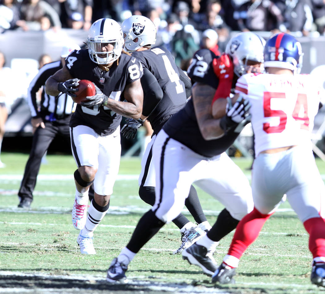 Oakland Raiders wide receiver Cordarrelle Patterson (84) runs with the football during the first half of a NFL game against the New York Giants in Oakland, Calif., Sunday, Dec. 3, 2017. Heidi Fang ...