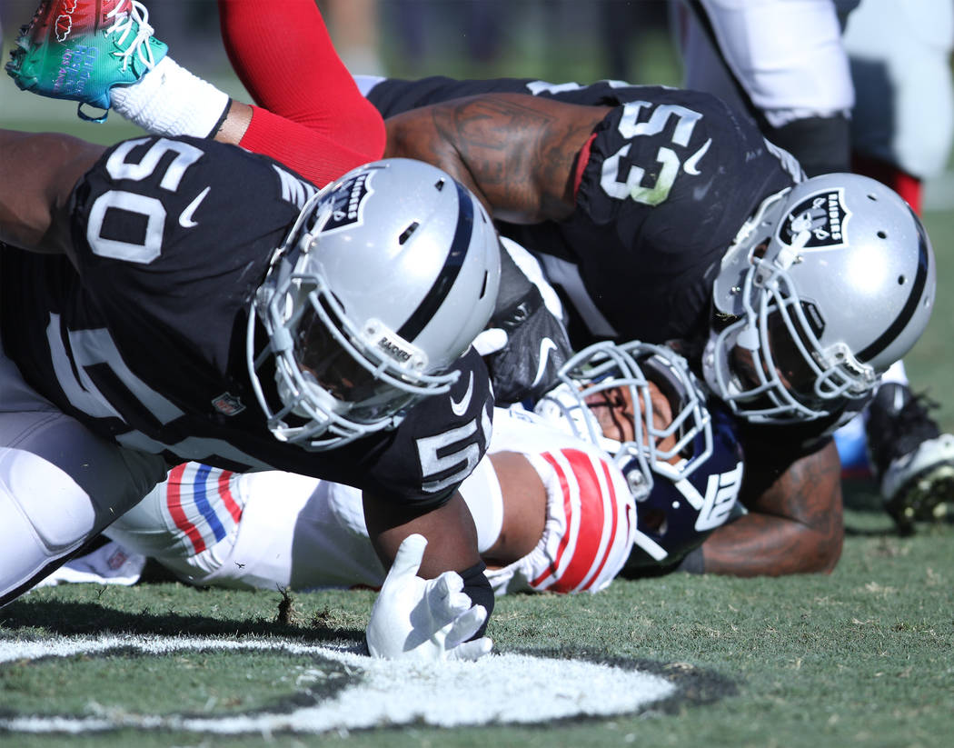 New York Giants running back Shane Vereen (34) is tackled by Oakland Raiders linebacker Nicholas Morrow (50) and middle linebacker NaVorro Bowman (53) during the first half of a NFL game in Oaklan ...