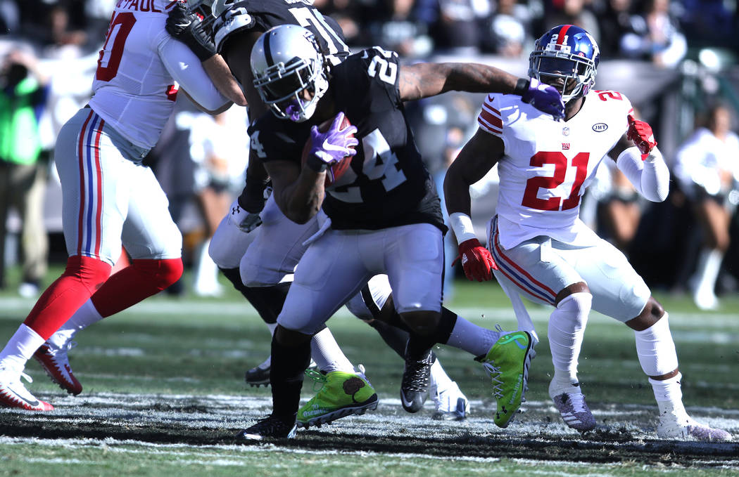 Oakland Raiders running back Marshawn Lynch (24) sheds a tackle from New York Giants strong safety Landon Collins (21) during the first half of a NFL game in Oakland, Calif., Sunday, Dec. 3, 2017. ...