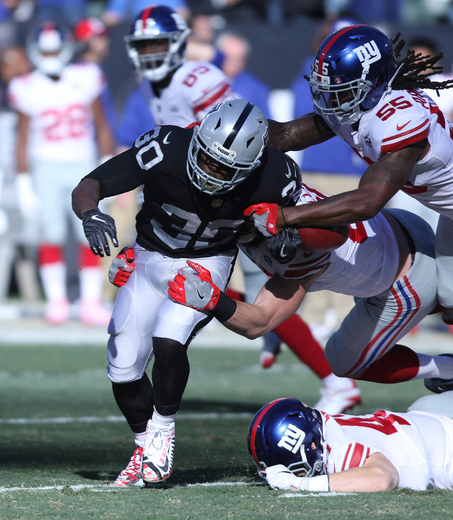 New York Giants linebacker Ray-Ray Armstrong (55) forces Oakland Raiders running back Jalen Richard (30) to fumble the football on a punt return during the first half of a NFL game in Oakland, Cal ...