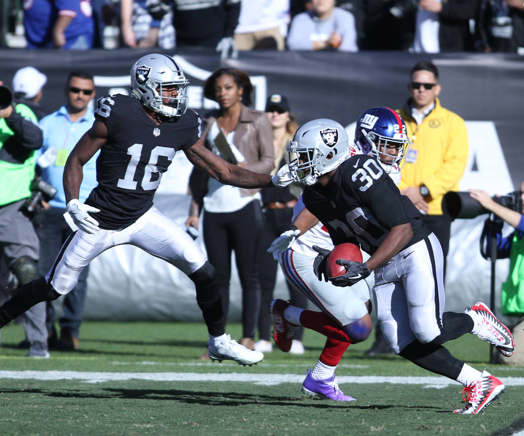 Oakland Raiders running back Jalen Richard (30) runs with the football during a punt return against the New York Giants during the first half of a NFL game in Oakland, Calif., Sunday, Dec. 3, 2017 ...