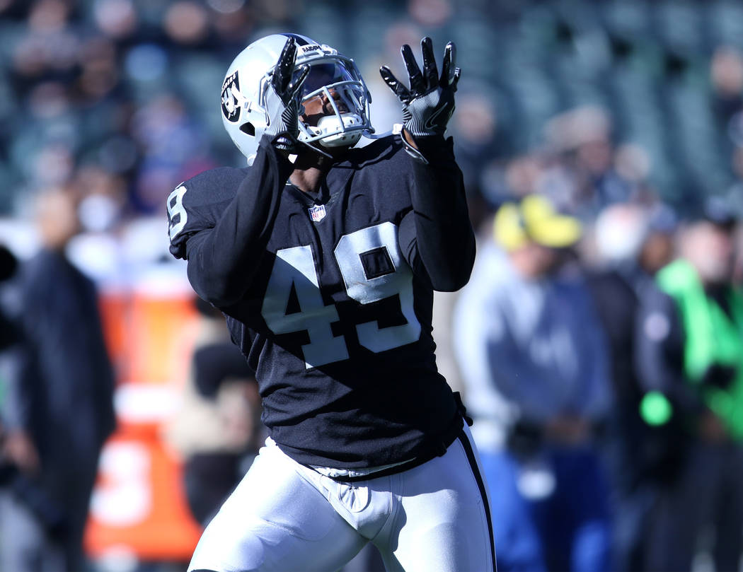 Oakland Raiders fullback Jamize Olawale (49) prepares to catch a pass during warm up drills ahead of the team's game against the New York Giants in Oakland, Calif., Sunday, Dec. 3, 2017. Heidi Fan ...