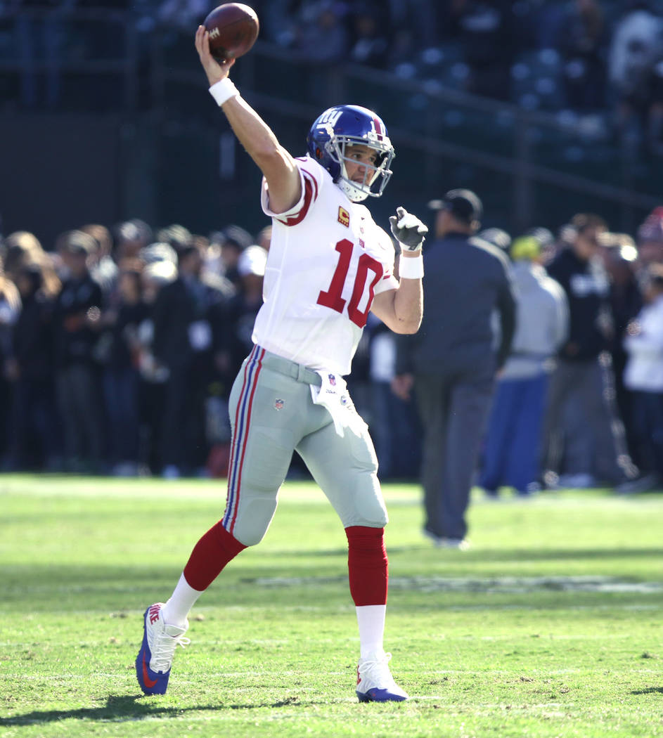 New York Giants quarterback Eli Manning (10) warms up ahead of the team's game against the Oakland Raiders in Oakland, Calif., Sunday, Dec. 3, 2017. Heidi Fang Las Vegas Review-Journal @HeidiFang