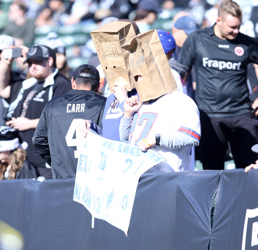 New York Giants fans wear paper bags over their heads prior to the start of the team's game against Oakland Raiders in Oakland, Calif., Sunday, Dec. 3, 2017. Heidi Fang Las Vegas Review-Journal @H ...