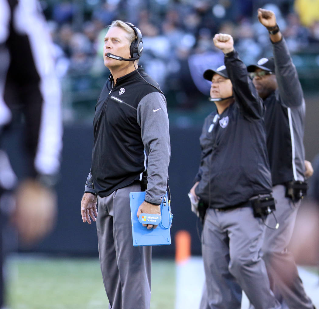 Oakland Raiders head coach on the sideline as defensive coordinator John Pagano calls a play during the first half of a NFL game against the New York Giants in Oakland, Calif., Sunday, Dec. 3, 201 ...