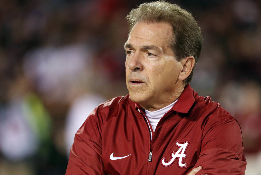 Alabama coach Nick Saban watches his team warm up for an NCAA college football game against Mississippi State in Starkville, Miss., Saturday, Nov. 11, 2017. (AP Photo/Rogelio V. Solis)