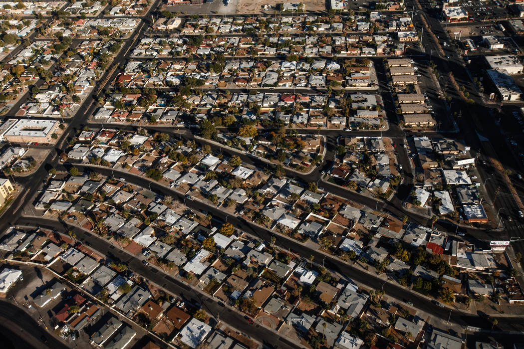 A view of residential homes as seen from inside a helicopter piloted by Joe Munoz, 41, of Maverick Helicopters, in Las Vegas, Friday, Dec. 1, 2017. Joel Angel Juarez Las Vegas Review-Journal @jaju ...