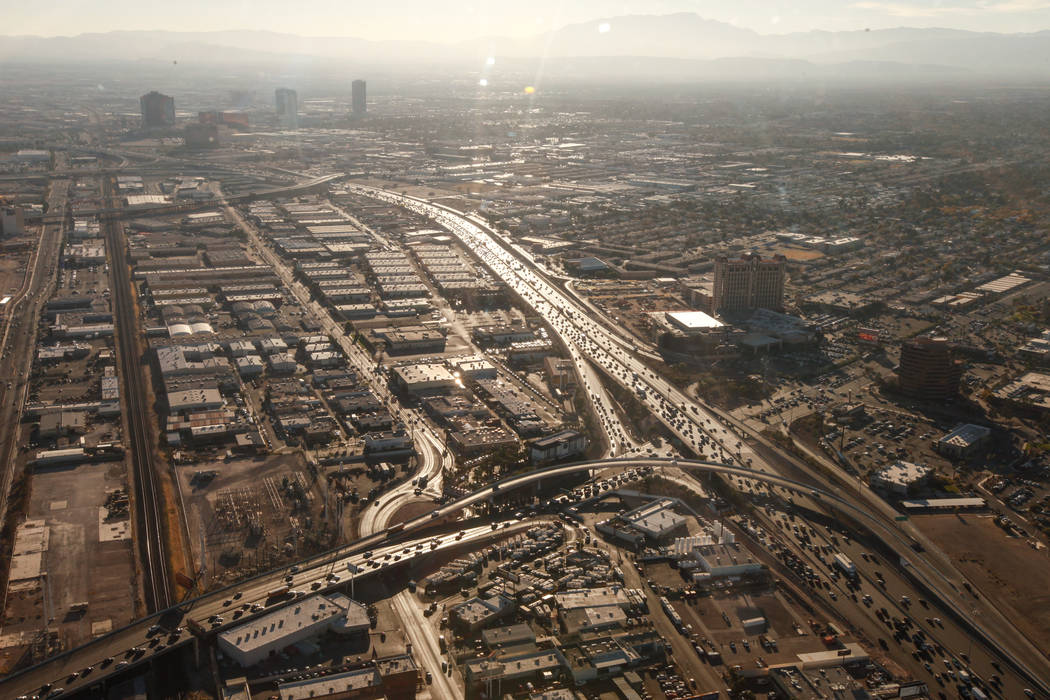 A view of traffic along Interstate 15 and State Route 589 as seen from inside a helicopter piloted by Joe Munoz, 41, of Maverick Helicopters, in Las Vegas, Friday, Dec. 1, 2017. Joel Angel Juarez  ...